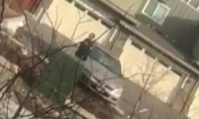 US police detain black man picking up rubbish outside home
