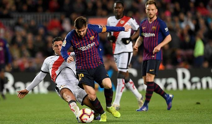 Messi and Suarez lead Barca to Rayo victory