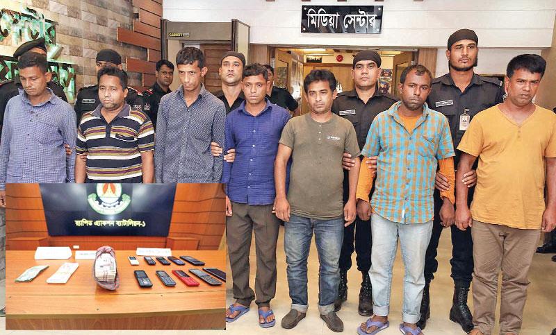 Seven 'fraudsters' arrested in city