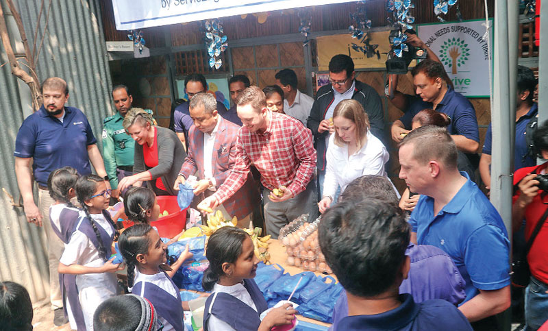 Along with others distributes food items and educational