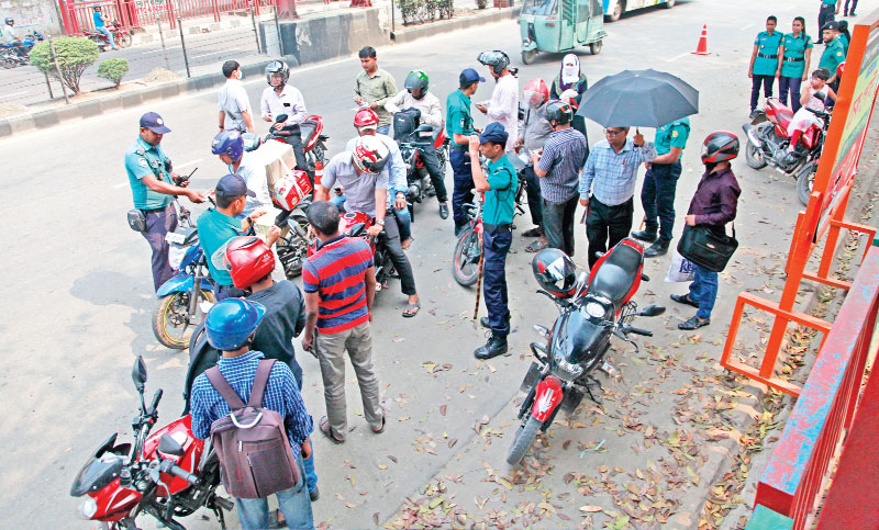 Policemen check documents of motorcycles