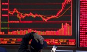 Asian shares mixed in muted trading ahead of US Fed meeting