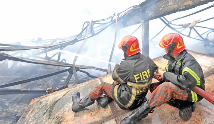 Members of Fire Service and Civil Defence battle