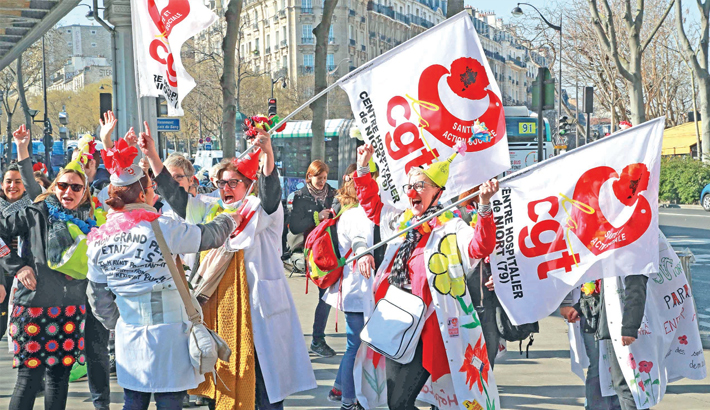 Psychiatric hospital caregivers take part in a demonstration