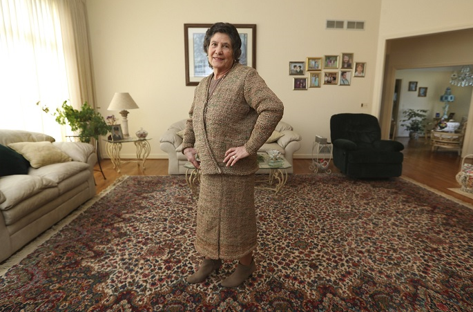 Woman makes suit of plastic bags