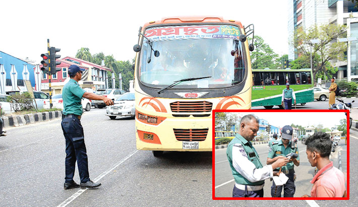 A traffic sergeant halts an inter-city bus at Jahangir Gate intersection in the city