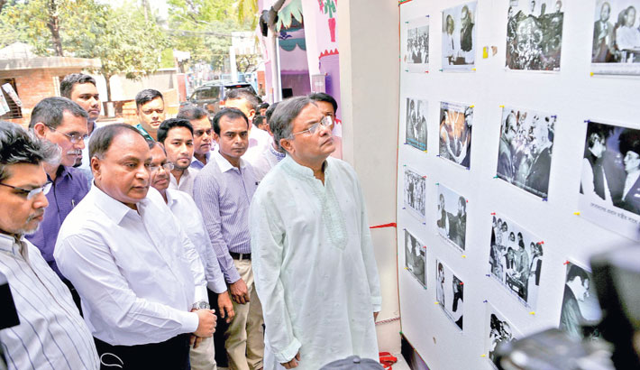 Information Minister Dr Hasan Mahmud admires a photo at a exhibition