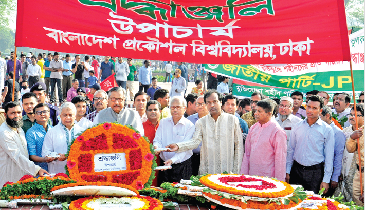 Placing a wreath at the National Memorial in Savar