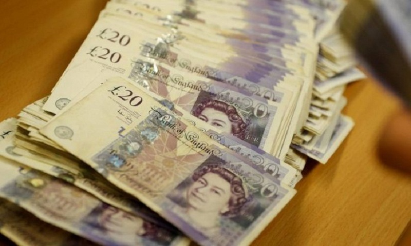 Pound falls after UK parliament rejects Brexit plan