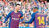 Messi magic fires Barcelona in Catalan derby