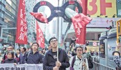 Protesters march along a street during a rally in Hong Kong