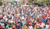 Jute mill workers block roads, railways