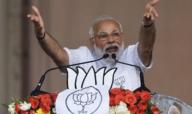India's Modi takes election fight to battleground state