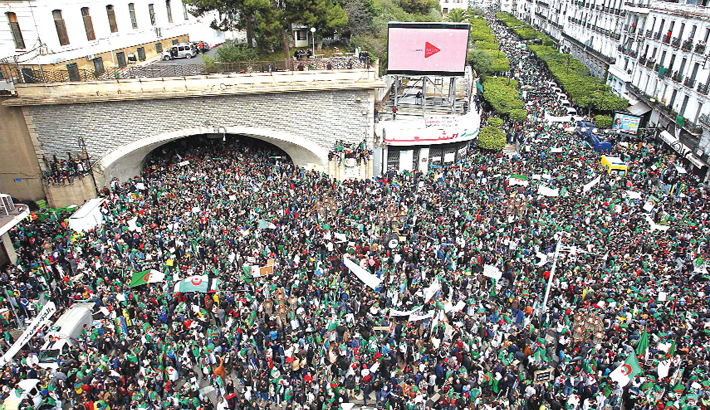 Algerians march during an anti-government demonstration