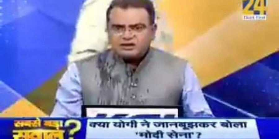 Congress leader throws water on BJP's spokesperson during live TV debate (Video)