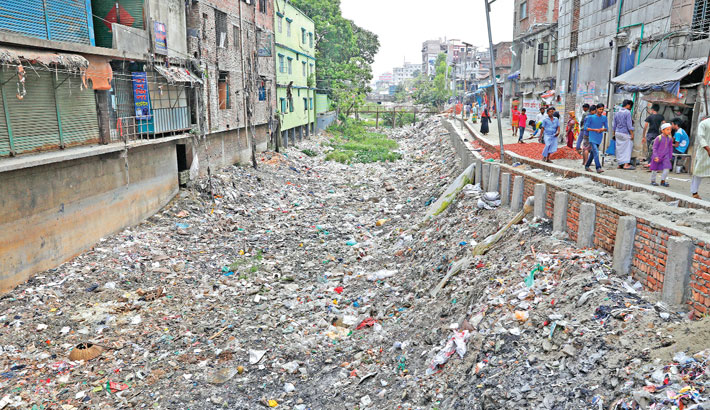 Kaliganj Bazar canal connected to the river Buriganga is filled with waste materials and it is now hard to call it a canal