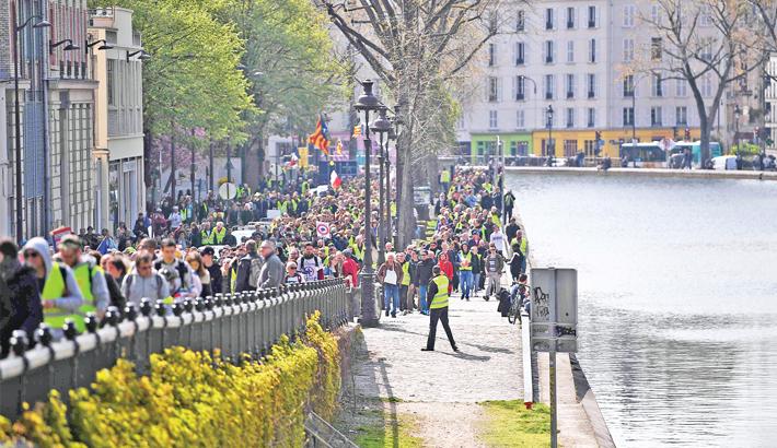 Protesters march along the Quai de Valmy in Paris