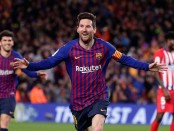Messi, Suarez lead Barca past 10-man Atletico to boost lead