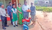Hands over a water pump to a poor farmer
