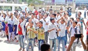 Students of Advocate Younus Mia Secondary School stage demonstration