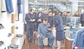North Korean leader Kim Jong Un (C) visiting Taesong Department Store