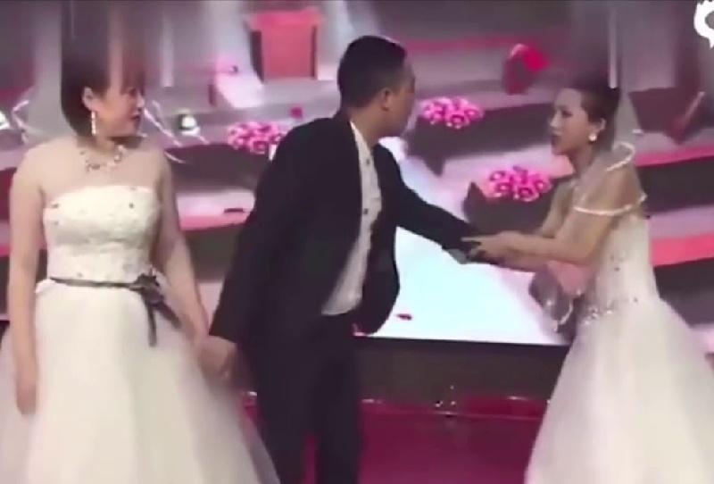 Bizarre Video! Woman dressed in bridal gown crashes ex-boyfriend's wedding