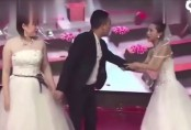 Bizarre Video! Woman dressed in bridal gown crashes ex-boyfriend's wedding