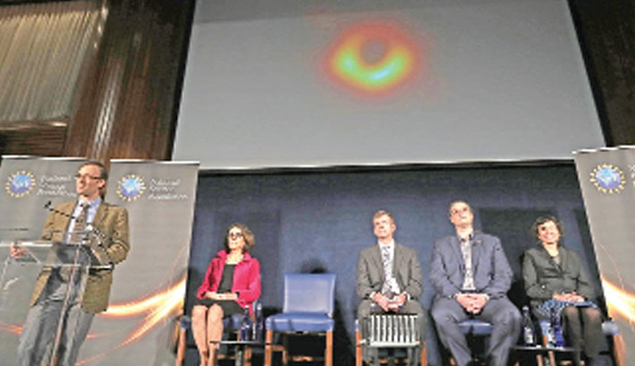 Astronomers deliver first photo of black hole