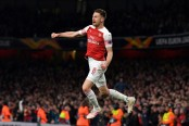 Ramsey sparkles as Arsenal sink Napoli