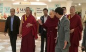 Dalai Lama says he feels almost normal as he leaves hospital