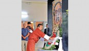 Bhutanese Prime Minister Lotay Tshering places a wreath