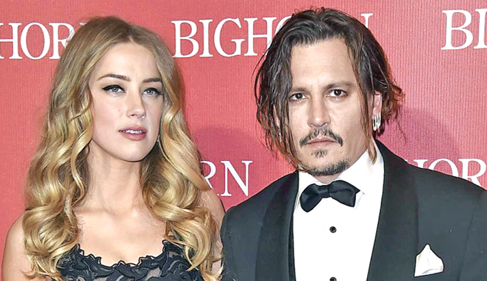 'Johnny Depp kicked me, slapped me,' alleges Amber Heard