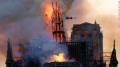 A fire that devastated Notre Dame Cathedral in Paris is under control, officials say