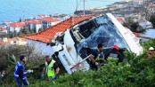 At least 28 killed after tourist bus plunges off road in Madeira