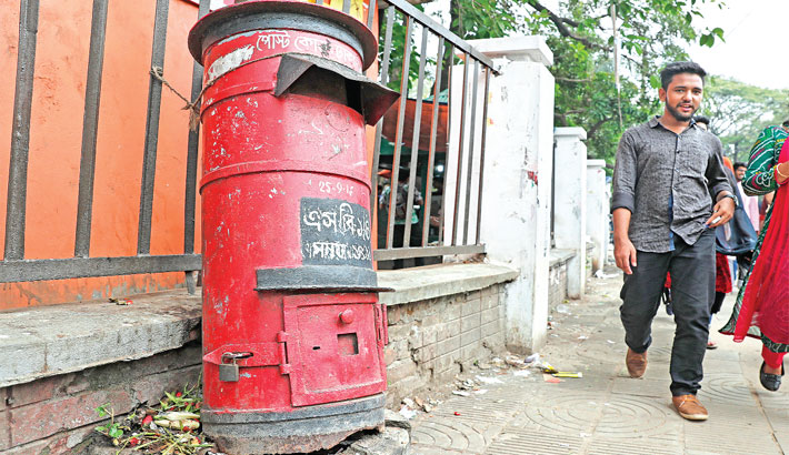 A post box lies damaged for long