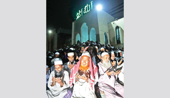 Devotees offer munajat (special prayers) at the Baitul Mukarram National Mosque