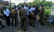 Sri Lanka deploys thousands of troops to look for bombing suspects