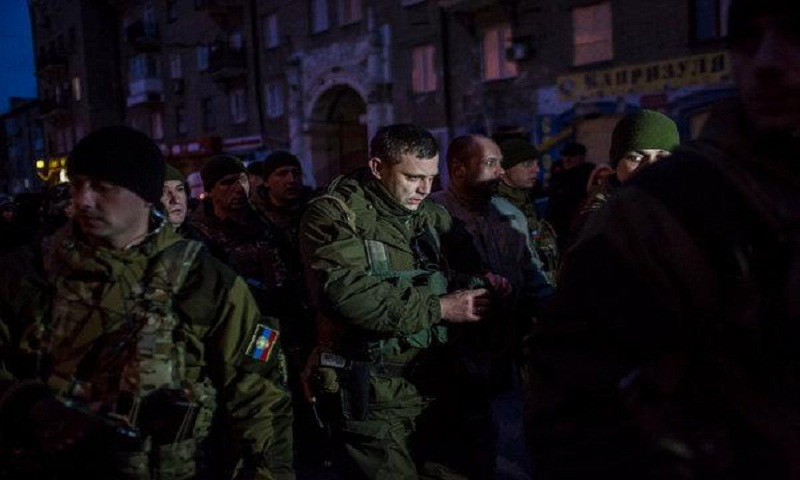 Mine blast in separatist-held Ukraine kills 4; 13 missing