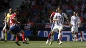 Atletico make Barca wait by squeezing past Valladolid
