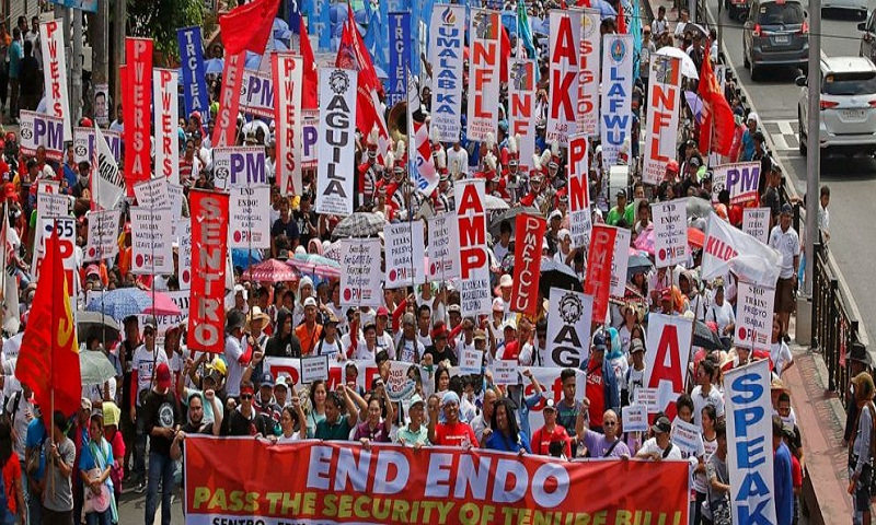 Thousands march on May Day, demand better working conditions