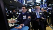 Asian shares mostly lower amid jitters ahead of trade talks