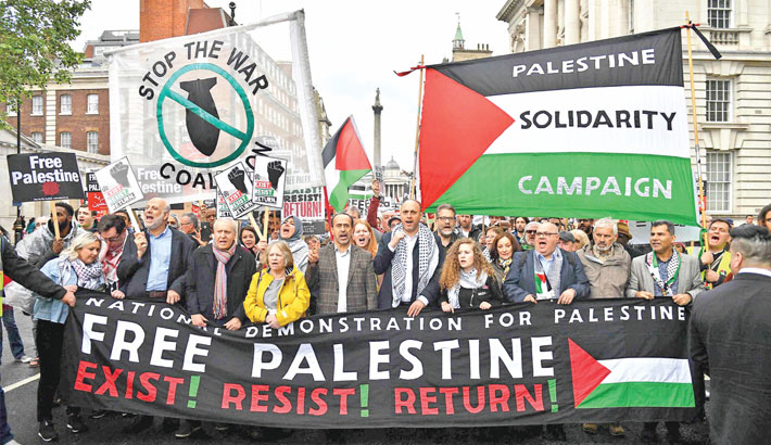 Palestinian activist Ahed Tamimi (centre right) joins a march calling for justice