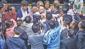 Hong Kong legislators brawl over extradition law