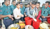 A mobile court of Dhaka Metropolitan Police (DMP) examines food items
