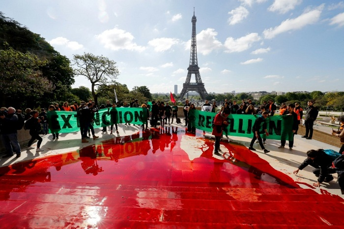 Fake blood flows at anti-extinction protest in Paris