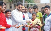 Symon Sadik distributes Iftar items among the  destitute people in the capital's