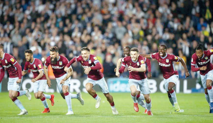 Aston Villa players celebrate after beating West Bromwich Albion