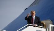 Trump lifts tariffs on Mexico, Canada, delays auto tariffs
