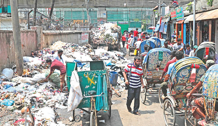 Almost half of a road at Fulbaria in the city has long been lying occupied with garbage