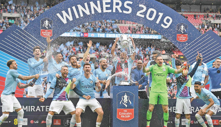 Man City complete treble in style